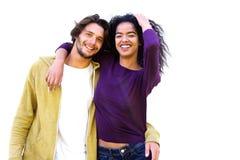 反对白色背景的微笑的夫妇 免版税库存照片