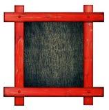 反对白色背景的老红色木制框架与在cente的黑木拷贝空间 免版税图库摄影