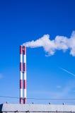 反对蓝天的两个管子烟 库存照片