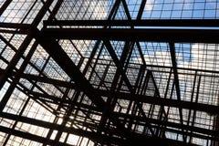 反对蓝天的几何结构与云彩 免版税库存图片