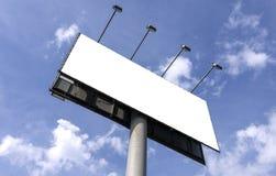反对蓝天的室外广告牌 免版税库存图片