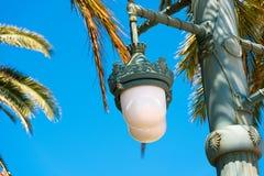 反对蓝天的街灯,在锡切斯,巴塞罗那, Catalunya,西班牙 复制文本的空间 查出在蓝色背景 免版税库存图片