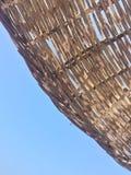 反对蓝天的遮阳伞与拷贝空间 库存照片
