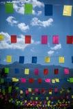 反对蓝色山的色的旗子 图库摄影