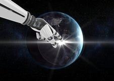 反对黑背景的机器人手感人的地球 库存照片