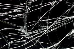 反对黑背景的残破的玻璃 库存图片