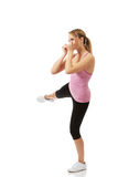 反撞力健身姿势的少妇 库存照片