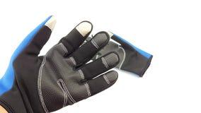 反滑动触摸屏蓝色和黑手套为冬天 免版税库存照片