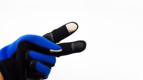 反滑动触摸屏蓝色和黑手套为冬天 免版税库存图片