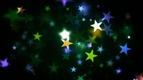 发光星的五颜六色的假日 免版税图库摄影