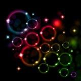 发光的五颜六色的起泡的背景 免版税库存图片