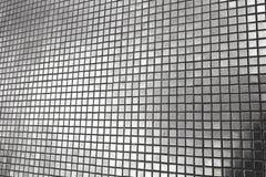 发光的灰色口气马赛克墙壁 免版税库存图片