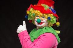 发光的玻璃的滑稽的小丑激动好快乐的 免版税图库摄影