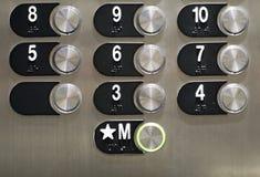 发光的电梯按钮 图库摄影