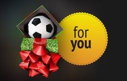 发光的礼物盒足球bal丝带黄色徽章黑暗的背景回报 库存照片