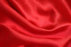发光的红色缎织品纹理 免版税图库摄影