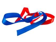 发光的缎蓝色和红色丝带 库存照片