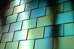 发光的金属墙壁 图库摄影