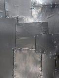 发光的金属补缀品摘要 免版税库存照片