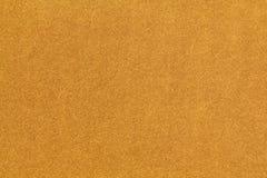 发光的金黄黄色粒状纹理 库存图片