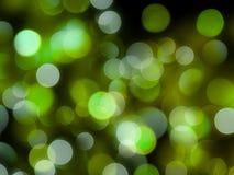 发光的鲜绿色的回合弄脏了光抽象夜背景 免版税库存图片