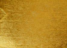 发光的黄色叶子金箔纹理背景 免版税图库摄影