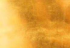 发光的黄色叶子金箔纹理 免版税库存照片