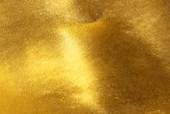 发光的黄色叶子金箔纹理 库存照片
