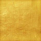 发光的黄色叶子金箔纹理背景 免版税库存图片