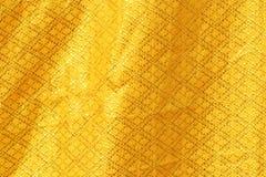 发光的黄色叶子金箔纹理背景 库存照片