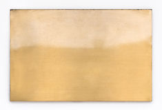发光的黄铜金属标志纹理 免版税库存照片