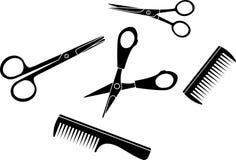 发刷被设置的美发师剪刀 免版税库存图片