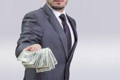 发单男孩拿着一百人货币一的美元风扇 免版税库存图片