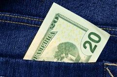 发单蓝色美元牛仔裤 免版税库存图片