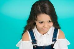 发型在蓝色背景的孩子模型 库存照片