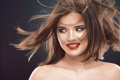 发型微笑的妇女画象 库存图片