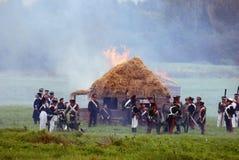 发烟和火在战场 库存图片