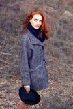 头发的纵向红色妇女 免版税库存照片