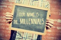 发短信给我们的名字是在黑板的millennials, vignetted 免版税库存图片
