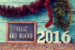 发短信给feliz ano nuevo 2016年,新年好2016年用西班牙语 库存照片