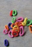 头发编织的色的橡皮筋儿 图库摄影