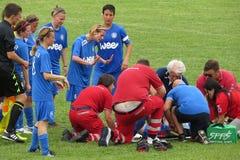 受伤的妇女球员 免版税库存图片