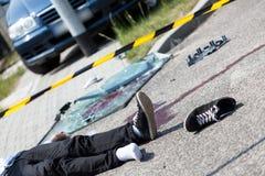 受伤的街道上的人 免版税库存图片