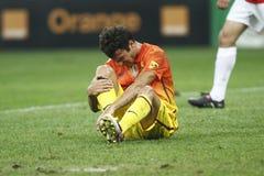 受伤的足球运动员- Cesc法布雷加斯 库存照片