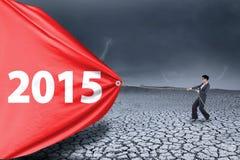 变动的雇员扯拽的第2015年 免版税库存照片