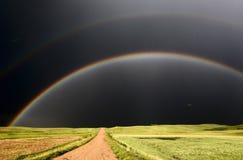 变暗的彩虹天空 库存照片