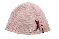变粉红色小女孩的被编织的帽子有装饰的 库存照片