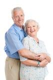变老的夫妇愉快微笑 免版税库存照片