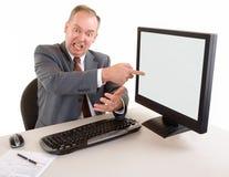 变老的恼怒的生意人中间名 库存图片