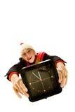 变老的时钟中间圣诞老人妇女 免版税库存照片